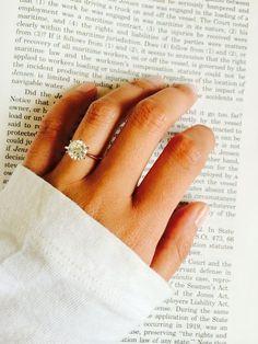 The round diamond sits on a pretty rose gold band. Image via WeddingBee.com »