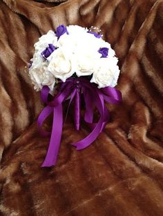 BRIDES ARTIFICIAL BOUQUET OF IVORY AND PURPLE ROSES, £26.99