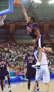 Vince Carter jumps over a guy to dunk in Olympics