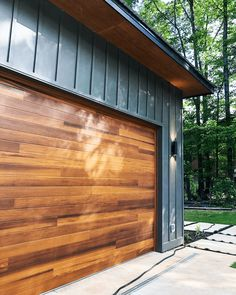Even up close, our Planks garage doors look as rich, authentic, and vibrant as natural wood. Order your free Accents Woodtones color samples today! Credit: @modernonthelake on Instagram. Modern Garage Doors, Wood Garage Doors, Wood Exterior Door, Garage Door Design, Exterior House Colors, Craftsman Remodel, Exterior Remodel, Custom Home Designs, Custom Homes
