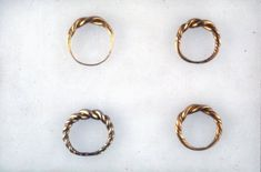 Gold finger-ring; hoop of circular section rods twisted with beaded wire; narrowing to back, 11th - 12th century, Gotland, Sweden