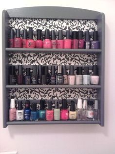 go to a thrift shop, find an old spice rack to paint, & hang in the bathroom for nail polish