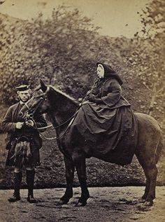 Queen Victoria on horseback with her longtime friend, John Brown.
