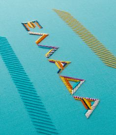 Embroidered typography bursting with colour from Maricor/Maricar