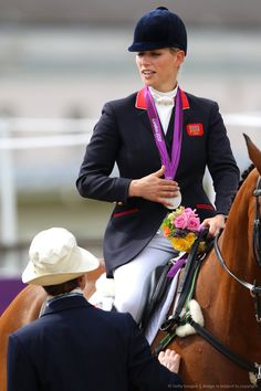 LONDON, ENGLAND - JULY 31: Zara Phillips riding High Kingdom speaks to her mother, Princess Anne, Princess Royal after receiving a silver medal after the Eventing Team Jumping Final Equestrian event on