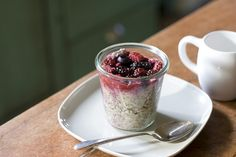 steel cut oats in a jar with berries and flax seeds.