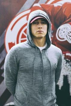 Eminem wears a grey zip Hoody by All Saints at a concert in Detroit