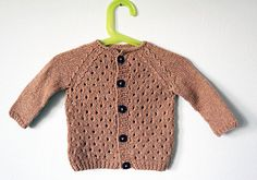 A wee little eyelet pattern cardigan I designed and made for my baby girl for the time when summer gives way to fall. I double stranded the Holst yarn and constructed the sweater bottom up with rag...