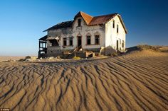 Tourists and photographers now flock to the area to see the formally grand German houses gradually sink