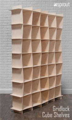 These large Baltic Birch Bookcases combine the natural beauty of raw wood with graceful architectural lines to create a beautiful wave pattern that will bring a bit of class into any room. Learn more about the durable wooden cube bookcase at Sprout.
