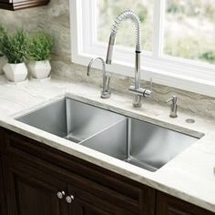 Picking a kitchen sink is a huge part of kitchen restoration. From typical top-mount sinks to newer, trendier devices like the reduced divider panel sink, think about which sort of sink suits your . Read Basic Kitchen Sink Types Ideas You Must Know Best Kitchen Sinks, Kitchen Sink Design, Kitchen Sink Faucets, Cool Kitchens, Kitchen Sink Ideas Undermount, Bar Sink, Stainless Steel Kitchen Sinks, Franke Kitchen Sinks, Remodeled Kitchens