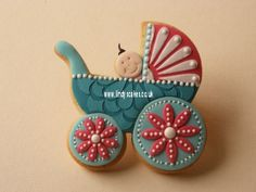 Baby pram cookie decorated by Lindy Smith