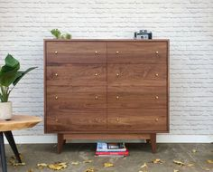 This is the dresser you were looking for. Beautiful, stylish and well made. Danish modern inspired, simple straight lines, walnut wood and brass knobs  48 L x 18 D x 44 H (8 legs, 36 body)  8 drawers Solid walnut leg base for extra support  Larger and smaller sizes also available  Other wood species available  Made to order. Please allow approx. 6-8 weeks for production.  Free NYC delivery  Rest of the US $200 - $400 depending on location  All images © 2010-2016 Marcelo Melamed. All Rights…