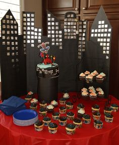 Spiderman cake table - I love the backdrop - would be so easy to make with black bristol board and tinfoil squares.