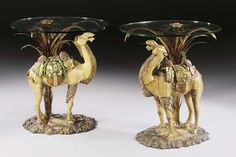 A PAIR OF CHINESE POLYCHROME-GLAZED EARTHENWARE TANG-STYLE CAMELS, NOW WITH ORMOLU PALM-TREES AND GLASS TOPS FORMING LOW TABLES THE CAMELS 20TH CENTURY, THE ORMOLU AND GLASS TOPS DESIGNED BY PIERRE DELBÉE OF MAISON JANSEN, PARIS, CIRCA 1965 - Christie's