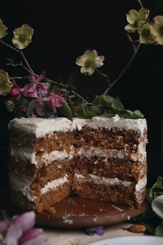 Classic Carrot Cake with Vanilla Bean Rum Frosting. Three layers of moist and flavorful carrot cake, iced with a smooth vanilla bean rum frosting.