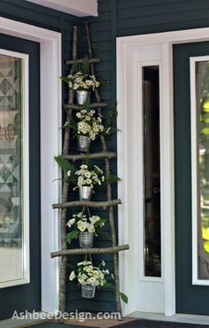 Wild Daisies decorating a handmade ladder of branches by Marji @ Ashbee Design.com
