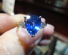 - This looks almost exactly like my sapphire ring except the cut of the stone is slightly different. The shape is the same, but the facets are slightly different. Tanzanite Rings, Hand Chain, Rare Gems, Young Justice, Chains, Catholic, Up, Heart Ring, Finger