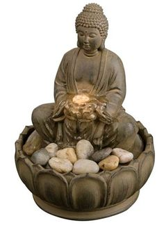 #Buddha #Illuminated #Tabletop #Fountain - Water bubbles up from the lotus in the Buddha's hands, softly illuminated.  Watch the video on our website for a demonstration!  #fountains