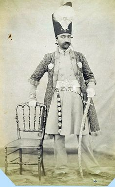 Portrait of Nasir al-Din Shah, ca. 1852–55, he wears a carefully chosen costume of European-style coat and trousers with a Persian robe, and a long sword hangs from his belt. These attributes accentuate both his cultural sophistication and military prowess. The practice of photography was taken up in Iran soon after its invention in Europe, and Nasir al-Din Shah was an enthusiastic amateur himself, by Luigi Pesce (Italian, active 1848–61).