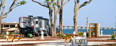St. Rosa RV Resort is an exclusive RV Park on Florida's Gulf Coast. We have 88 spacious luxury RV camping sites located directly on Santa Rosa Sound in the popular family vacation town of Navarre Florida. St. Rosa RV waterfront resort is located near the Florida Panhandle's famous sugar white sand beaches and the emerald green waters of the Gulf of Mexico.