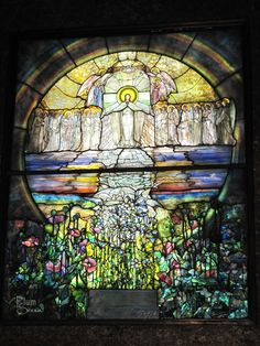 """This 7' x 9' window is The Flight of Souls, by Louis Comfort Tiffany. Before its installation in the Wade Chapel in 1901, Tiffany shipped it to Paris for the 1900 World Exhibition, where it was prominently displayed at the entrance to the U.S. pavilion. It helped Tiffany to win his first gold medals from the L'Exposition Universelle. The window consists of several layers of a highly specialized glass known as """"Favrile,"""" which is known for its multicolored striations, opalescence…"""