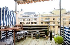 use awning fabric to give a balcony more privacy...great idea!