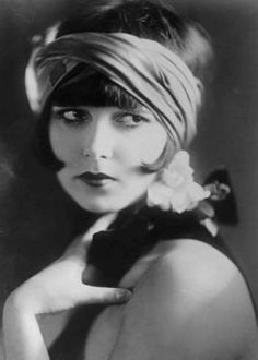 """""""A well dressed woman, even though her purse is painfully empty, can conquer the world"""" - Louise Brooks"""
