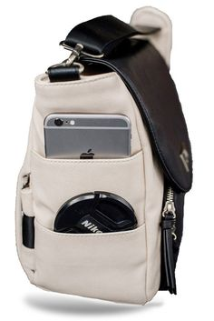 BLACK & IVORY 'HIPSTER' - Heidi Haden  The 'HEIDI HADEN HIPSTER' camera bag is designed to be comfortably worn around your hips! This function takes all of the pressure off of your neck and keeps your gear secure at your side while providing easy access to your lenses and gear. The hip straps tuck neatly away when you'd prefer to carry it as a shoulder bag only!