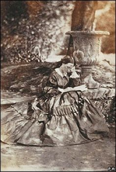 """Florence Nightingale gained worldwide attention for her work as a nurse during the Crimean War. She was dubbed """"The Lady with the Lamp"""" -making rounds at night to tend to injured soldiers. Early photographs of her are very rare because she was extremely reluctant to be photographed because she avoided personal publicity.The photo was discovered in an album of mid 19th century photographs and shows Florence sitting reading outside her family home two years after her return from the war."""