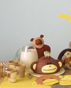 From Martha Stewart - Monkey party!    Serve drinks in cups animated with construction paper. Use hole and craft punches to punch construction-paper circles for eyes, ears, and mouth; attach with glue stick. For mouth, cut circle in half, and leave a gap; for ears, fold back a tab. Cut a paper tail; curl around finger.