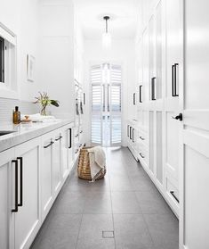 """At six metres long, this laundry offers an abundance of storage space. """"We included drying cupboards and lots of spots for the owner to… Laundry Room Wall Decor, Laundry Room Signs, Laundry Room Storage, Storage Spaces, Drying Cupboard, Cupboard Storage, Drying Room, Modern Laundry Rooms, Laundry Design"""