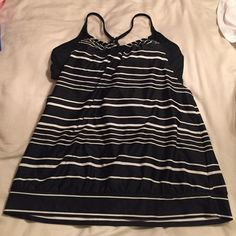 Athleta tankini. Bra support and loose overlay Athleta black and white stripe tankini with bra support and loose overlay. Super flattering. Athleta Swim Bikinis