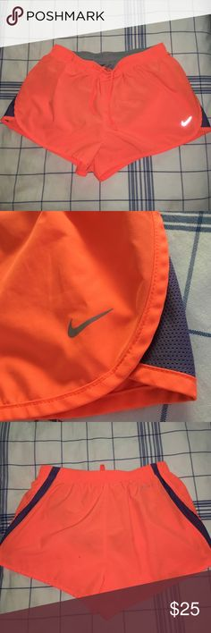 Bright Orange Drifit Nike Running Shorts These bright shorts are the comfiest pair of running shorts I've ever owned. Whether you like to exercise or not, they are a great pair of shorts for romping around. There's a minuscule spot on the back (see pics) but besides that these are in perfect condition Nike Shorts