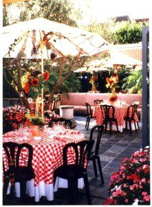 italian themed party -- white table cloth w/red checked tablecloth over