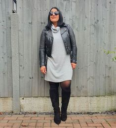 Jas wearing a winter sweater dress with a moto jacket and boots   40plusstyle.com