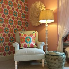 Colorful little girls room with coordinating Thibaut wallpaper and pillow fabric.