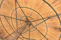 underneath of a straw umbrella