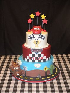 Disney Cars Cake - Lightning McQueen & Tow Mater are toys, White cake with Buttercream Icing, signs are edible images on gumpaste. This cake was a donation for Icing Smiles, an organization that gives custom cakes to a critically ill child or their sibling. If you haven't signed up to volunteer, I encourage you to do so. They need experienced and amateur bakers.