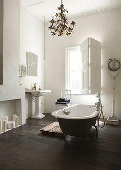 """I like the """"vintage"""" type look of this bathroom~The chandelier, the tub, the really old school scale, and loving the candles in the little nook area~"""