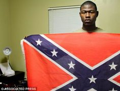 In an interview, Thomas said a class research project made him come to the belief that the flag's real meaning has been hijacked by racists groups. He said he wants people to thoughtfully consider issues of race and not just knee-jerk reactions to such symbols. 'When I look at this flag, I don't see racism. I see respect, Southern pride,' he said.  'This flag was seen as a communication symbol' during the Civil War.