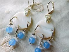 Mother pearl dangling Earrings made with aquamarine stone beads and flower glass beads and silvertone lever back earrings.#E00303 by DesignImagesLLC on Etsy