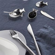 fuksas adds fish-themed salt cellar and oyster knife to colombina cutlery set for alessi Modern Tabletop, Modern Dinnerware, Kitchenware, Tableware, Daniel Libeskind, Alessi, Natural Lip Balm, Fish Shapes, Cutlery Set