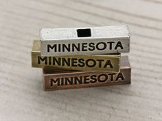 The 212 west Minnesota necklace pendant, combined with others in our inspirational collection is a soulful expression of where you come from. Like the water flowing through the Minnesota River, your style should reflect the strength and unwavering consistency of Minnesota pride. #midwestisbest #minnesotagirl