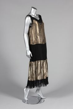 Cocktail dress, late 1920s-early 30s. Gold lame wi/ tiers of black mesh and gold lame. Kerry Taylor Auctions
