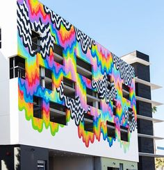 emblazoned across the flagship location of platform  a retail venue in culver city california  is technicolor ooze a drippy and trippy mural by los angeles-based artist jen stark. #designboom #jenstark by designboom