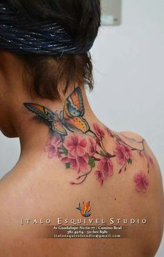 Beautiful Cherry Blossom tattoo! Never thought of that placement but i love how it looks on her with the butterfly on her neck! Beautiful Tattoo!