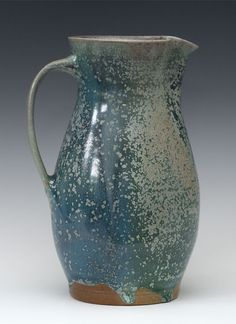 Paul Herman (Great Basin Pottery)     Oribe-glazed pitcher fired in the salt chamber.