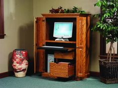 Amish Heirwood Computer Armoire Desk The Heirwood is an ideal home workspace, made to fit in any room. Built in the dimensions, wood and stain that work best for you. You can conceal the desk area behind exquisite raised panel bi fold doors. #computerarmoiredesk #armoiredesk #homeoffice