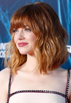 Emma Stone's long bob with that fire red colour gives us hair envy. This is perfect for people with curly hair wanting a new do.